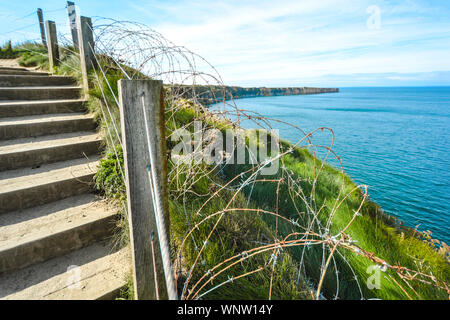 The coast of Normandy France, Pointe du hoc where the allied forces faced the Germans during World War 2, with barbed wire, - Stock Photo