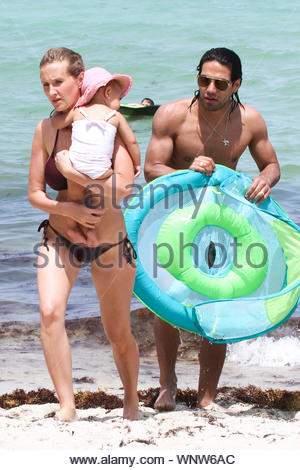 Miami, FL - Radamel Falcao García Zárate, commonly known simply as Radamel Falcao, his wife Lorelei Taron and their cute baby Dominique soak up the Miami Sun, Falcao is a Colombian football striker, who plays for AS Monaco in the French Ligue 1 and represents the Colombia national football team. AKM-GSI June 20, 2014 - Stock Photo