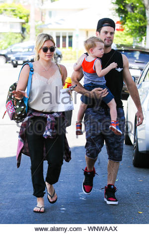 Beverly Hills, CA - Hilary Duff and ex Mike Comrie take their little son Luca out for breakfast at a local restaurant in Beverly Hills. Since announcing their split in January, the two have surprised fans by subsequently taking a 'Modern Family' vacation together with their tot, and even rocking out, sans Luca, at the Coachella Music and Arts Festival last month. AKM-GSI June 21, 2014 - Stock Photo