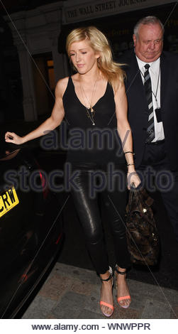 London, UK - Ellie Goulding and Dougie Poynter leave the Chiltern Firehouse after an evening together. The couple walked out of the club hand in hand the day after pictures of Calvin Harris going back to Ellie's house surfaced. The couple could then be seen smiling in the back of their car as they head home together. AKM-GSI June 24, 2014 - Stock Photo