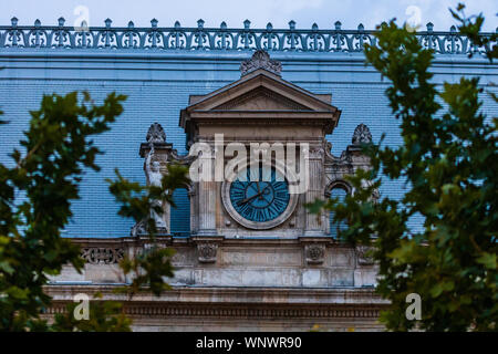 Detail view of the clock from the Palace of Justice building from Bucharest, Romania - Stock Photo