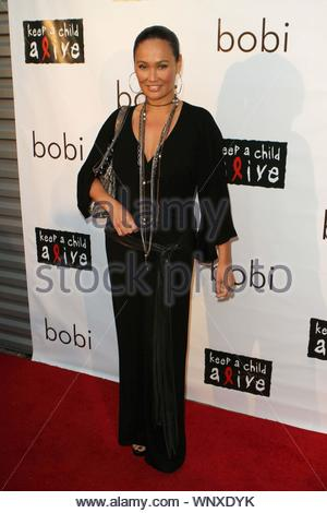 West Hollywood, CA - Revolve Clothing hosted the bobi Sample Sale For A Cause event showcasing Kara Lusardi's bobi clothing line, with all proceeds donated to the Keep a Child Alive foundation. Stars that hit the red carpet were co-host Ali Landry (Pic 1,9,11,12,15,22), Tia Carrere (Pic 2,8,13,17,19,21,23) and co-host Sophie Monk (Pic 2,9,11,15,19,23), Chrishell Stause from 'All My Children' (Pic 3,16,), Kara Lusardi (Pic 4,9,11,15,18), E!'s 'D10' host Catt Sadler (Pic 5,), Vanessa Lengies from 'Hawthorne' (Pic 6,9,10,11,15,20), and Lisa Locicero from 'General Hospital'. GSI Media June 23, - Stock Photo
