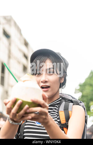 Young Asian cute woman traveler tourist shopping walking on the famous local street market with backpack , food local , vacation,hipster tourism conce - Stock Photo