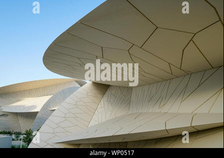 DOHA QATAR - JULY 10 2019;Architectural detail National Museum of Qatar unusual but striking design form is inspired by desert rose crystal opened in - Stock Photo