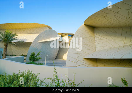 DOHA QATAR - JULY 10 2019; National Museum of Qatar unusual but striking design form is inspired by desert rose crystal opened in March 2019  designed - Stock Photo