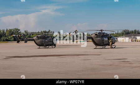 OPA-LOCKA, FLORIDA , FLORIDA (4 September 2019) -- Florida National Guard Soldiers and Airmen, from the CBRN Enhanced Response Force Package (CERFP), load equipment and prepare for potential missions responding to Hurricane Dorian. (Photo by Ching Oettel) - Stock Photo