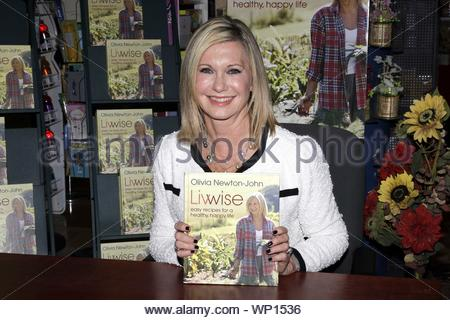 New York, NY - Olivia Newton-John was at Barnes and Noble in New York today for her 'Livwise' book signing where she posed with her new book and signed autographs for fans. Olivia will also be opening a world-class Cancer and Wellness Centre in Australia this July. AKM-GSI April 28, 2012 - Stock Photo