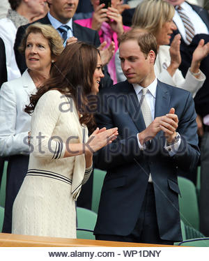 London, UK - The Duchess of Cambridge, Kate Middleton sits court side with husband Prince William during the 2012 Wimbledon Championships. Kate and Williams watched Roger Federer take on Mikhail Youzhny. AKM-GSI July 4, 2012 - Stock Photo