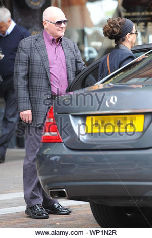 London, UK - Actor Anthony Hopkins gets some shopping done at Harrods in London, looking great in a violet button up shirt with a plaid coat and sunglasses. AKM-GSI September 12, 2012 - Stock Photo