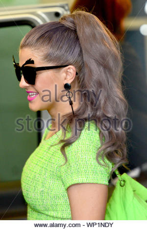 London, UK - Kelly Osbourne with boyfriend, Matthew Mosshart seen leaving the ITV studios dressed in a bright lime green top and bright pink lipstick. AKM-GSI September 18, 2012 - Stock Photo