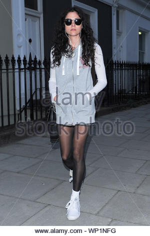 London, UK - Eliza Doolittle goes for an evening stroll alone, dressed in a gray sweater with black leggings and sunglasses in London as she listens to music. AKM-GSI September 19, 2012 - Stock Photo
