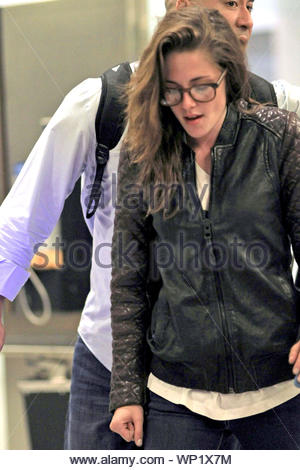 Toronto, Canada - A disheveled Kristen Stewart arrives at the airport for the Toronto International Film Festival. AKM-GSI September 5, 2012 - Stock Photo