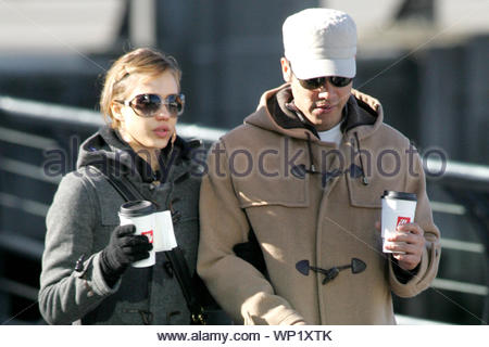 ARCHIVE PHOTOS Vancouver, BC - Jessica Alba and boyfriend Cash Warren hit the outdoors to walk her dog Bowie in Vancouver, Canada. Jessica looked stylish and cute in her charcoal peacoat, Dolce & Gabbana sunglasses, leather messenger bag, black leggings, and leg warmers over her metallic pink Converse sneakers. The attractive couple warmed up over a cup of Illy's coffee. AKM-GSI October 30, 2006 - Stock Photo