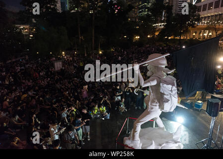 Hong Kong, China. 06th Sep, 2019. Protesters gather in front of an anti-extradition movement statue during the demonstration.Thousands of anti-government protesters held a rally condemning the 'white terror' in the latest demonstration of the anti-extradition movement. The rally remained peaceful with various figures giving speeches and protesters simultaneously lifting their phones in support of the movement. Credit: SOPA Images Limited/Alamy Live News - Stock Photo