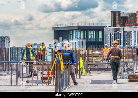 Kiev, Ukraine - September 05, 2019: Active preparatory work is ongoing for concreting at the construction site of a residential building. Surveyor eng - Stock Photo