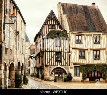 Old half-timbered houses on Town Hall Square of Noyers (Noyers-sur-Serein).   Noyers is beautiful medieval French village  in Burgundy, north-central - Stock Photo