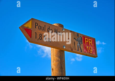 Prazares, Madeira and a wooden direction sign indicating a footpath to Paul do Mar. - Stock Photo