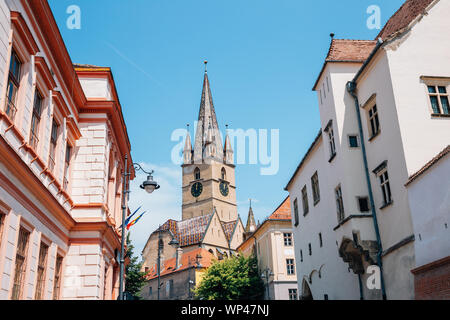 Lutheran cathedral of saint mary and old town in Sibiu, Romania - Stock Photo