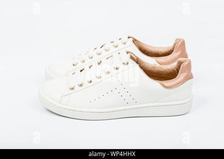 Women's sport leather shoes on white background. - Stock Photo