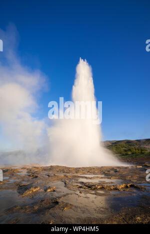 Eruption of the Geysir geyser. Valley Haukadalur, Iceland. Golden Ring Tourist Attraction - Stock Photo