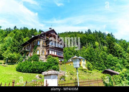 House on Wolfgangsee lake by in St Gilgen with alps mountains, boats, Sailboats. Salzkammergut, Salzburg, Austria - Stock Photo