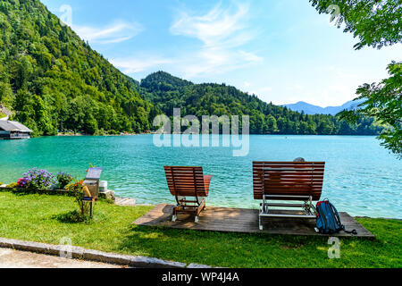 Beautiful view on Wolfgangsee lake by in St Gilgen with alps mountains, boats, Sailboats. Salzkammergut, Salzburg, Austria - Stock Photo