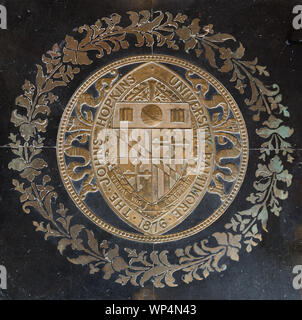 Johns Hopkins University seal on the floor of Gilman Hall, on the Johns Hopkins University campus in Baltimore, Maryland - Stock Photo
