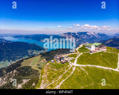 Amazing panorama view from Schafberg by Sankt Wolfgang im Salzkammergut on Haus house Schafbergspitze, lake Attersee. Blue sky, alps mountains. Upper - Stock Photo