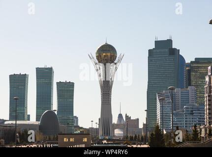 NUR-SULTAN, KAZAKHSTAN - APRIL 30, 2014: Baiterek architectural building in the center of the capital of Kazakhstan in sunset light - Stock Photo