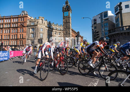 Glasgow, Scotland, UK. 7th September, 2019. The peloton turns into London Road at the start of stage one of the OVO Energy Cycling Tour of Britain which is Britain's biggest professional cycle race and the longest stage of this year's race covering 125 miles from Glasgow to Kirkcudbright. Credit: Skully/Alamy Live News - Stock Photo