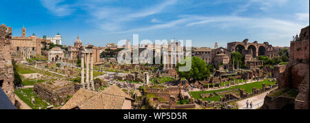 ROME, ITALY - APRIL, 2018: Panoramic view of the ancient ruins of the Roman Forum in Rome - Stock Photo