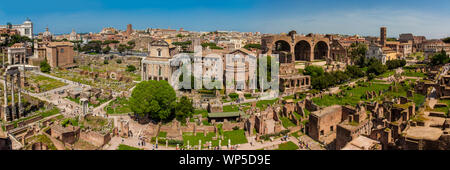 ROME, ITALY - APRIL, 2018: Panoramic view of the ancient ruins of the Roman Forum and the Colosseum in Rome - Stock Photo