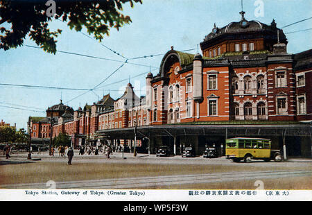[ 1930s Japan - TITLE ] —   Tokyo Station, located in the Marunouchi business district of Tokyo, near the Imperial Palace grounds and the Ginza commercial district.  The building was designed by architect Kingo Tatsuno (辰野金吾, 1854–1919) to celebrate Japan's victory in the Russo-Japanese War. He patterned the domes, destroyed during the firebombings of 1945 (Showa 20), after Amsterdam's central station.  The station was completed on December 18, 1914 (Taisho 3), and opened on the 20th. In 1921 (Taisho 10), Prime Minister Takashi Hara was assassinated here.  20th century vintage postcard. - Stock Photo