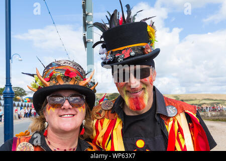 Swanage, Dorset UK. 7th September 2019. Crowds flock to the seaside town of Swanage to enjoy the dancing, with over 50 dance teams including morris dancing at the Swanage Folk Festival. Morris dancers, members of Ragged Phoenix Morris. Credit: Carolyn Jenkins/Alamy Live News - Stock Photo