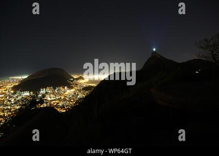 Christ the Redeemer and Corcovado mountain in Rio de Janeiro, Brazil - Stock Photo