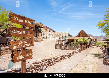 Calico ghost town California, USA. May 29, 2019. Directional sign arrows on wooden post in a sunny spring day - Stock Photo