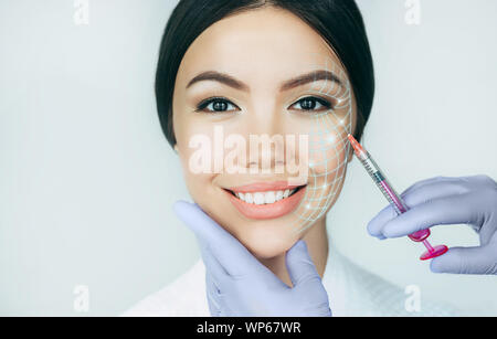 Portrait asian woman with lifting lines , showing face lift concept. Save youthful skin with lifting injection - Stock Photo