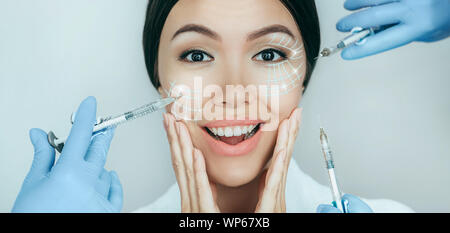 Portrait of amazing female face with lifting lines , showing face lift concept. Save youthful skin with injection - Stock Photo