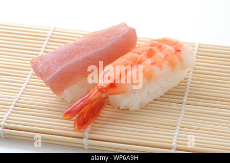 japanese sushi set closeup isolated on white background shrimp and tuna - Stock Photo