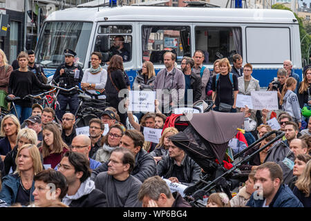 Germany, Berlin, Cnr. Invalidenstrasse & Ackerstrasse. 7th September 2019.Vigil for four people killed in accident as a Porche SUV ploughed onto sidewalk of Friday evening. Berliners gathered to mourn the dead and bring flowers & candles to the site of the accident. There was also a call for SUV vehicles to be restricted in the city and for a new speed limit. credit: Eden Breitz/Alamy - Stock Photo