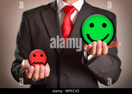 Businessman with emoticons in his hands representing success.. Horizontal composition. Front view. - Stock Photo