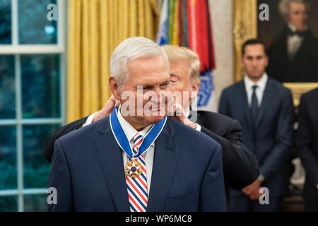 Washington, DC, USA. 05 September, 2019. U.S President Donald Trump, right, awards the Presidential Medal of Freedom, to Hall of Fame Los Angeles Lakers basketball star and legendary NBA General Manager Jerry West during a ceremony in the Oval Office of the White House September 5, 2019 in Washington, DC. - Stock Photo