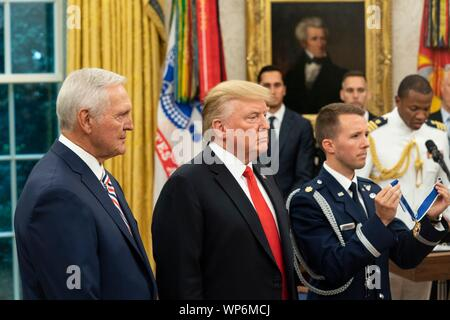 Washington, DC, USA. 05 September, 2019. U.S President Donald Trump, center, awards the Presidential Medal of Freedom, to Hall of Fame Los Angeles Lakers basketball star and legendary NBA General Manager Jerry West during a ceremony in the Oval Office of the White House September 5, 2019 in Washington, DC. - Stock Photo