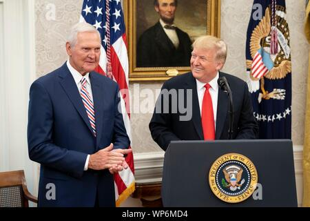 Washington, DC, USA. 05 September, 2019. U.S President Donald Trump delivers remarks prior to awarding the Presidential Medal of Freedom, to Hall of Fame Los Angeles Lakers basketball star and legendary NBA General Manager Jerry West during a ceremony in the Oval Office of the White House September 5, 2019 in Washington, DC. - Stock Photo