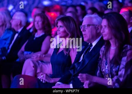 Washington, DC, USA. 05 September, 2019. U.S. First Lady Melania Trump applauds during the REACH performance at the John F. Kennedy Center for the Performing Arts September 5, 2019 in Washington, D.C. Sitting with the First Lady is David Rubenstein, right, co-founder of the Carlyle Group. - Stock Photo