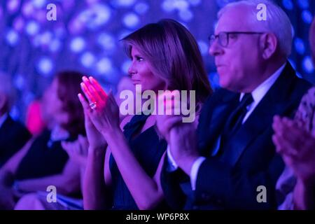 Washington, DC, USA. 05 September, 2019. U.S. First Lady Melania Trump applauds during the REACH performance at the John F. Kennedy Center for the Performing Arts September 5, 2019 in Washington, D.C. Sitting with the First Lady is David Rubenstein, co-founder of the Carlyle Group. - Stock Photo