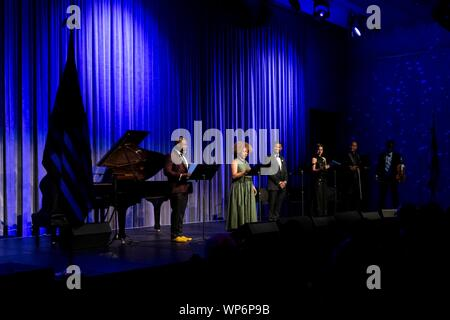 Washington, DC, USA. 05 September, 2019. A Reach spoken word performance at the John F. Kennedy Center for the Performing Arts attended by U.S. First Lady Melania Trump September 5, 2019 in Washington, D.C. From left, performers Marc Bamuthi Joseph, Alfre Woodard, Usher Raymond, Larisa Martinez, Kevin Sylvester and Wilner Baptiste. - Stock Photo