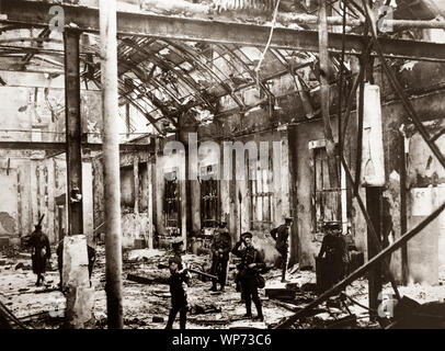 British soldiers standing in the badly damaged General Post Office (GPO) in Sackville Street (now O'Connell  Street) Dublin. During the Easter Rising of 1916, the GPO served as the headquarters of the uprising's leaders. It was from outside this building on the 24th of April 1916, that Patrick Pearse read out the Proclamation of the Irish Republic. The building was destroyed by fire in the course of the rebellion, save for the granite facade, and not rebuilt until 1929, by the Irish Free State government. - Stock Photo