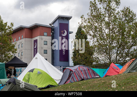 Protest encampment at Defence & Security Equipment International DSEI arms fair trade show, ExCel, London, UK. Protesters tents. Camp. Premier Inn - Stock Photo