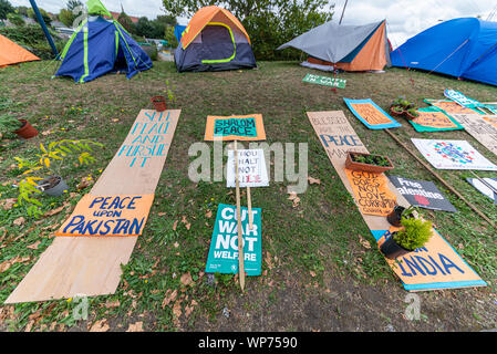 Protest encampment at Defence & Security Equipment International DSEI arms fair trade show, ExCel, London, UK. Protesters tents. Camp. Peace Pakistan - Stock Photo
